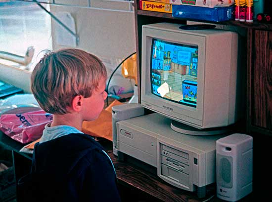 young-boy-in-school-inform-playing-a-home-computer
