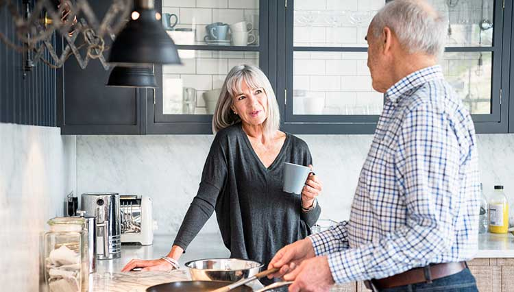 mature couple chatting in the kitchen