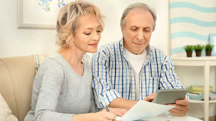 mature couple looking over their paperwork
