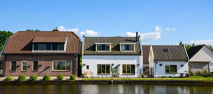 Downsizing: 3 houses on a riverbank ranging for big to small