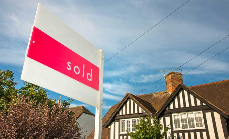 Equity release: Sold sign outside traditional English home