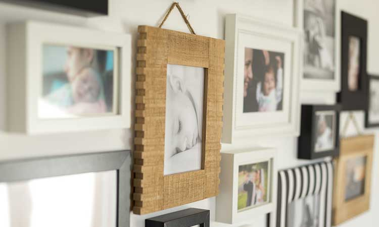 Staying in your home: Family photos clustered on a wall
