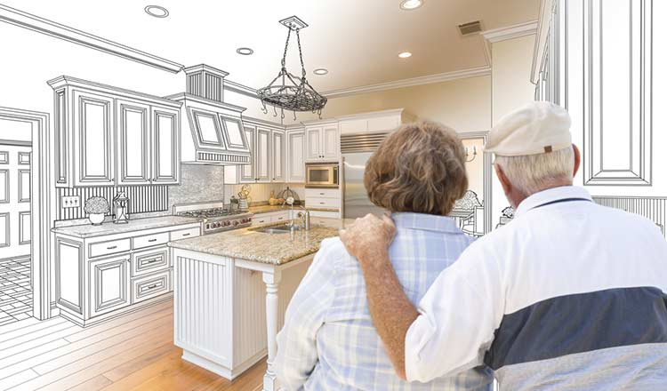 older couple looking at a potential new kitchen