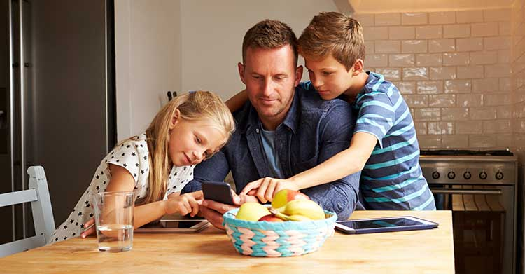 Family life cover – father and children sitting at kitchen table