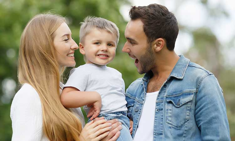 Life insurance protects family — young couple hold their son