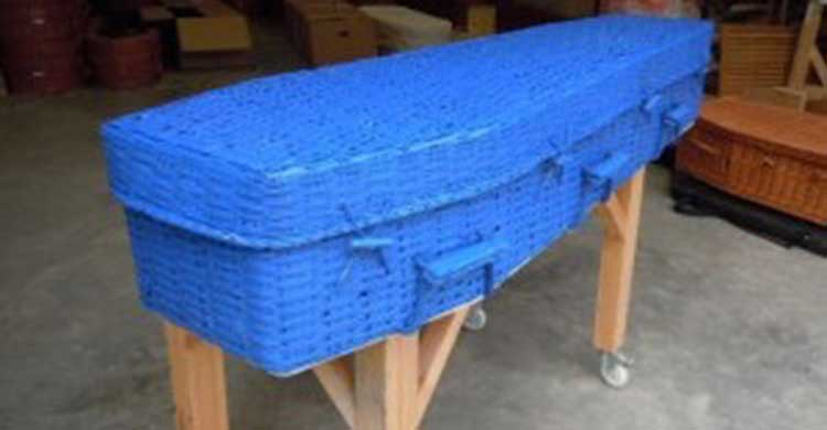 Bright blue wicker coffin made from bamboo