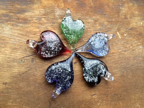 5 pretty stained glass hearts laid out like a flower