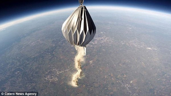 Ashes falling from a concertina balloon high above the earth