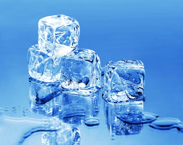 Ice cubes piled up on a cool blue background