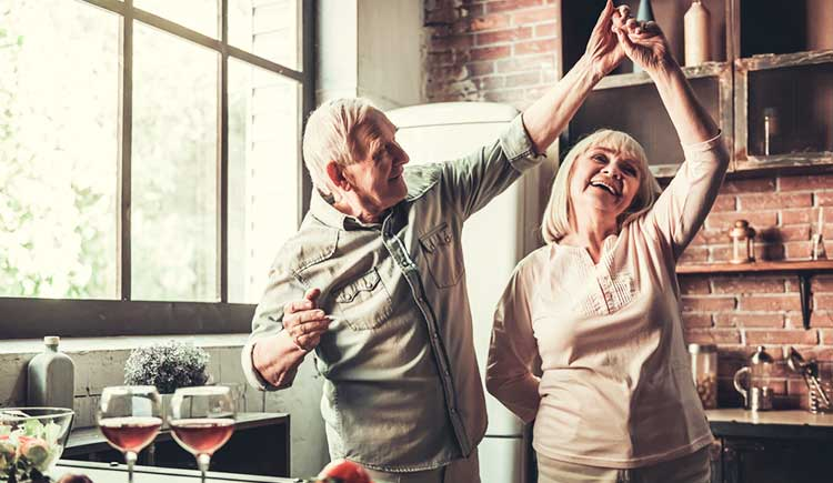 mature couple dancing in the kitchen