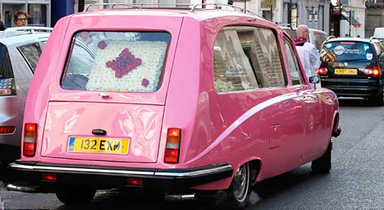 a candy pink hearse carried Roger Lloyd-Pack to his funeral