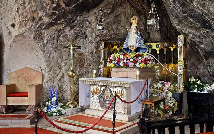 the virgin of covadonga on her alter in asturias