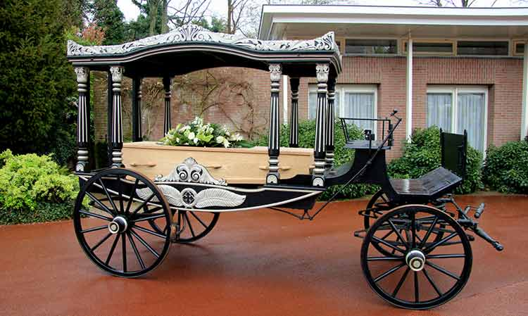 a coffin on a horse drawn carriage