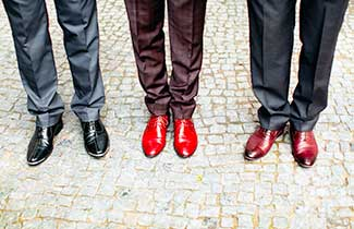A line of 3 mens legs in suits with polished shoes