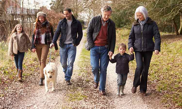 Peace of mind life cover: 3 generations of family walking the dog