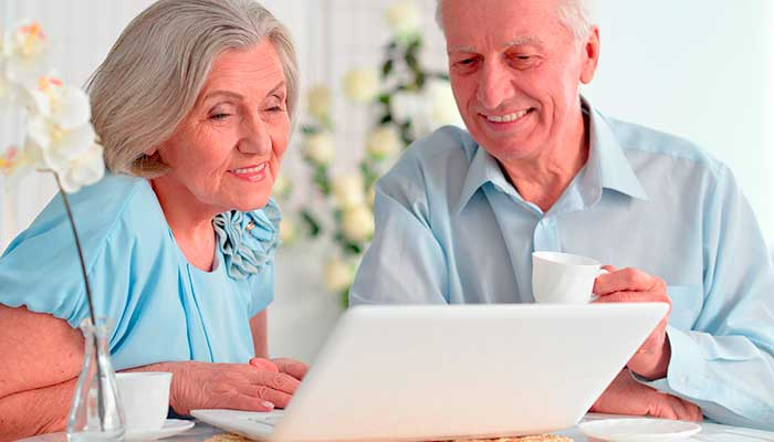 older couple looking at a laptop