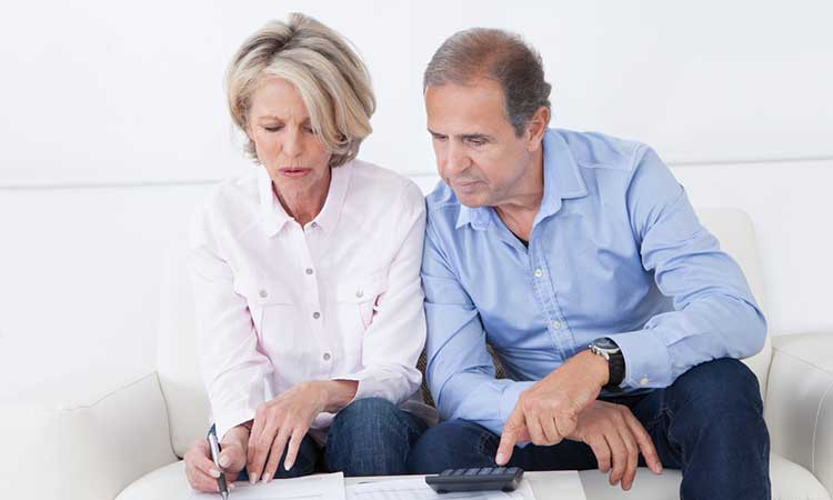 Considering over 50 life cover: mature couple reviewing paperwork
