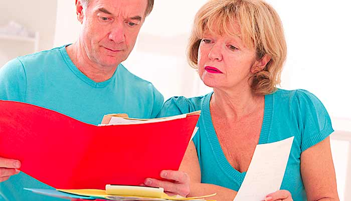couple looking at administrative and financial document