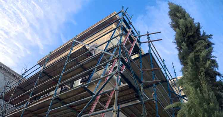 Buildings cover: Scaffolding around a building