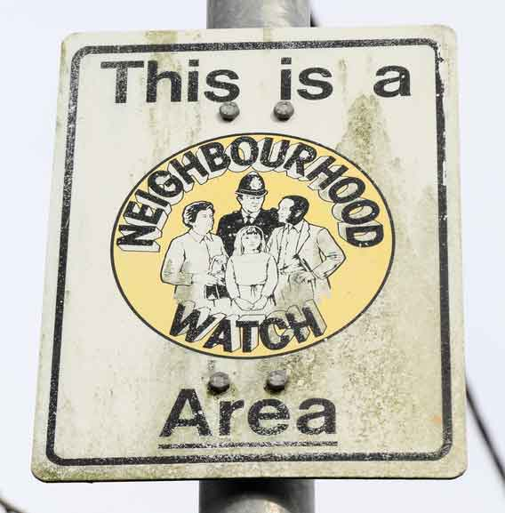 Contents insurance costs: Neighbourhood watch sign on lamp post