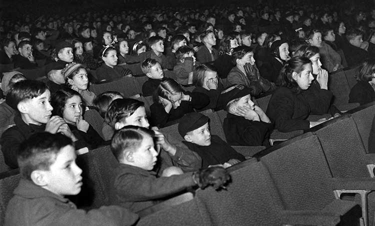 A cinema packed with children, all staring intently at the screen