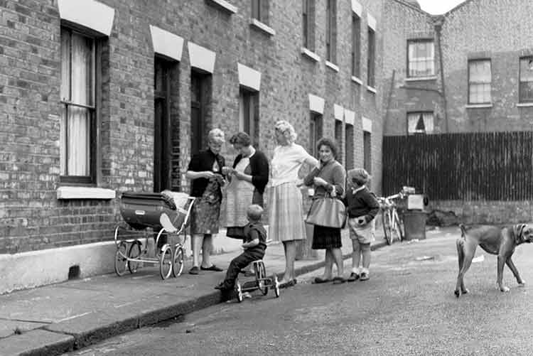 Mums with a pram and children playing in the street