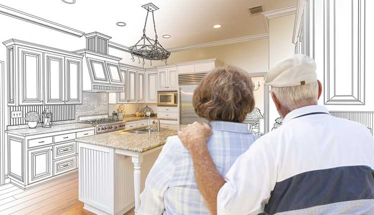 couple looking at a line drawing of a kitchen