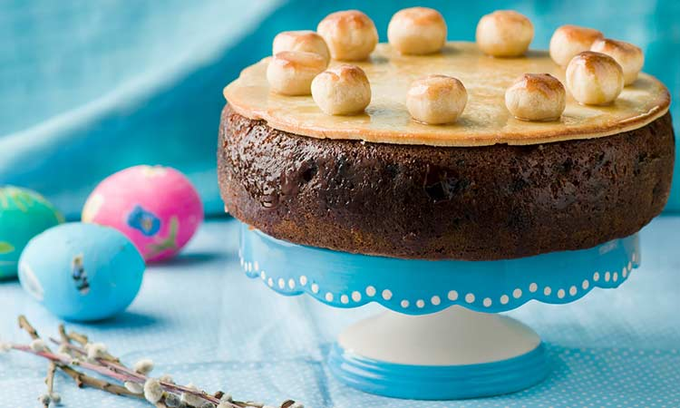 a simnel cake on a cake stand