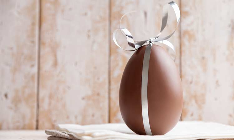 chocolate easter egg with a ribbon round it