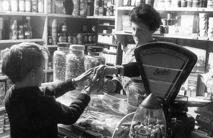 boy being served in a sweet shop