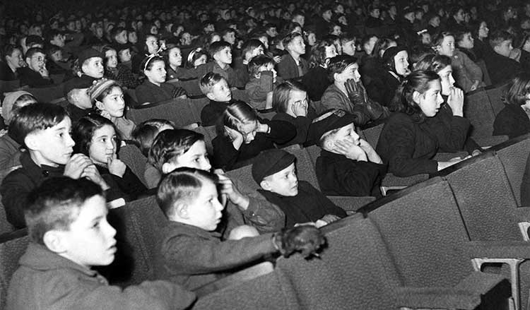 children watching a film at the cinema