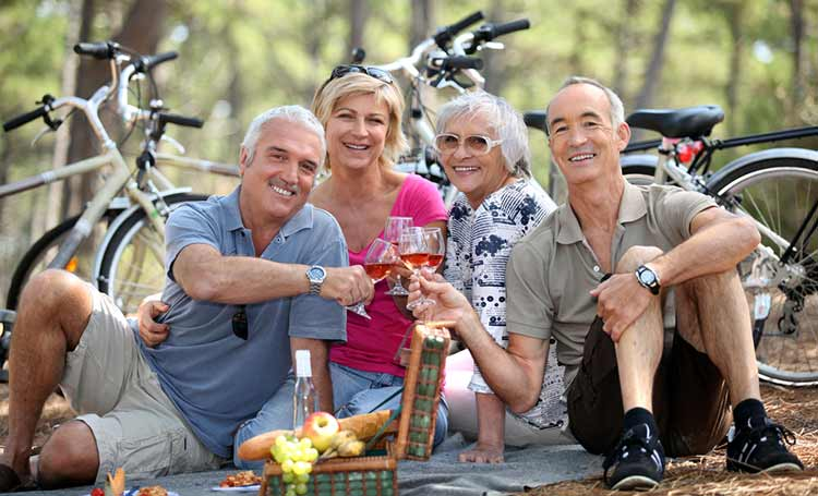 two cycling couples having a picnic together