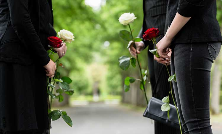 mourners carrying roses