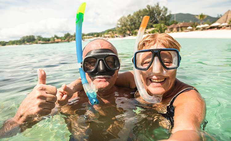 couple snorkeling on holiday