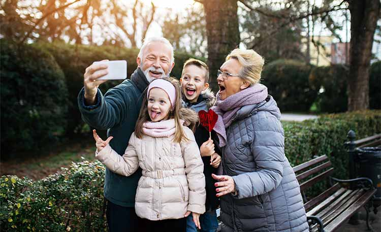 grandparents taking a selfie with the grandkids