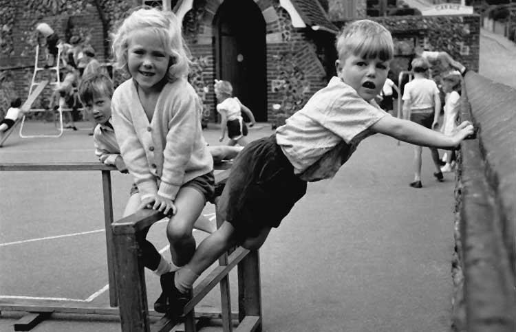 children on a wooden climbing frame in the playground