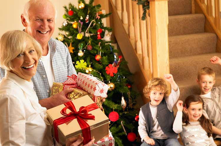grandparents handing out presents to the grandchildren
