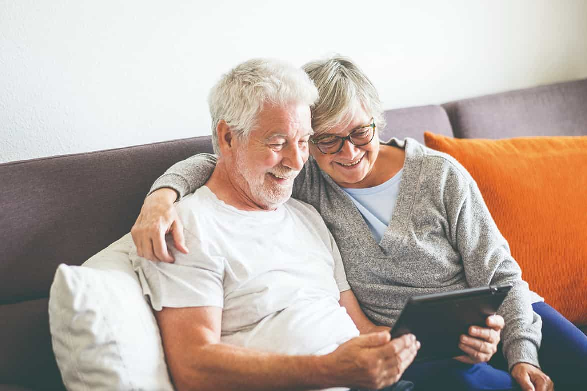 Older couple at home on their iPad