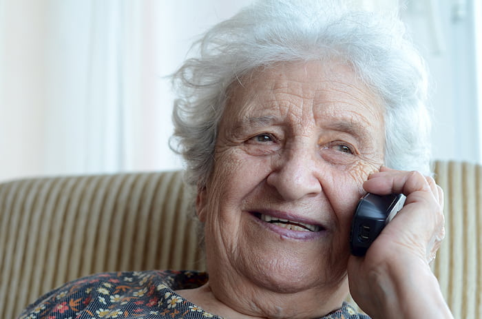 Senior woman on the phone at home