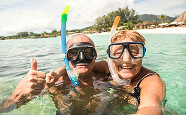 over 50s couple snorkling.