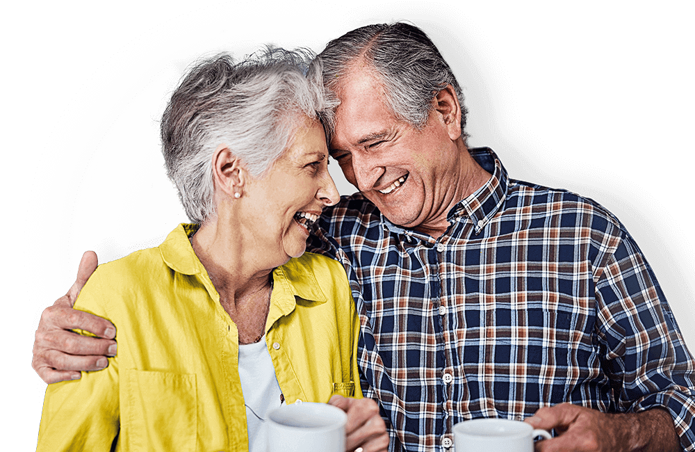 Home insurance, over 50s couple leaning their heads against one another and smiling.