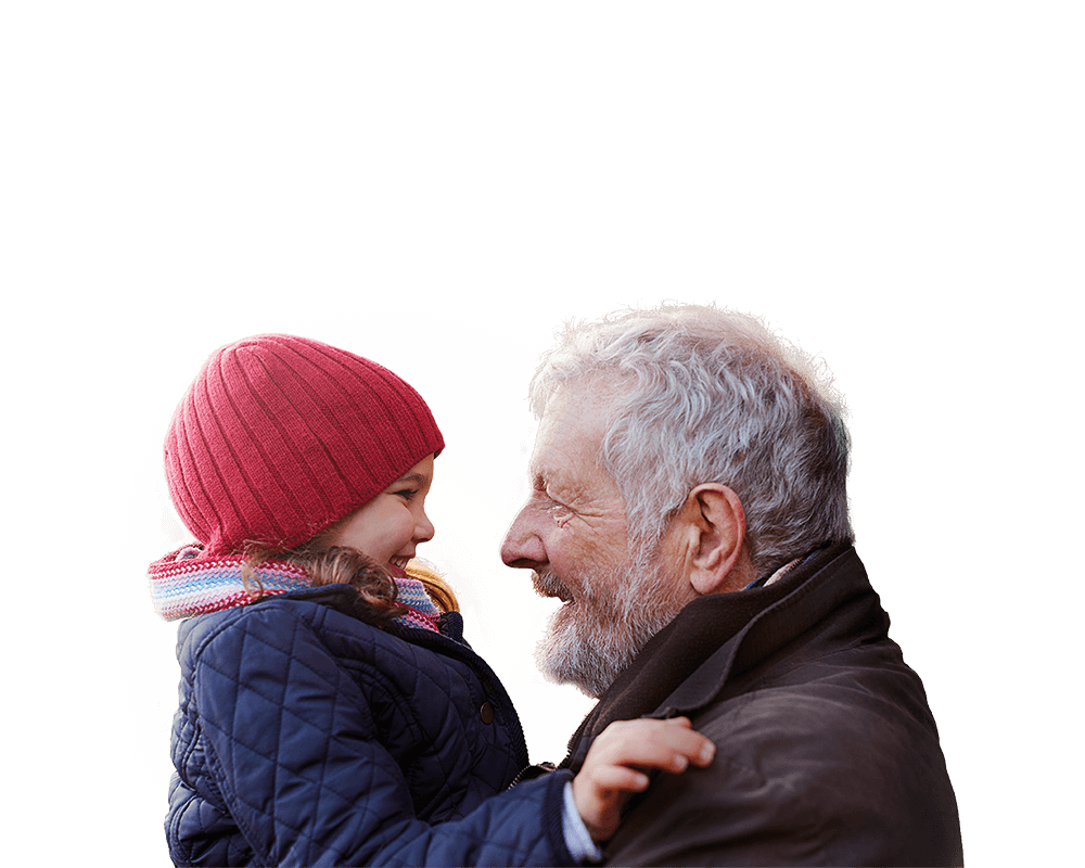 Grandfather wearing a dark coat with his granddaughter wearing a red hat