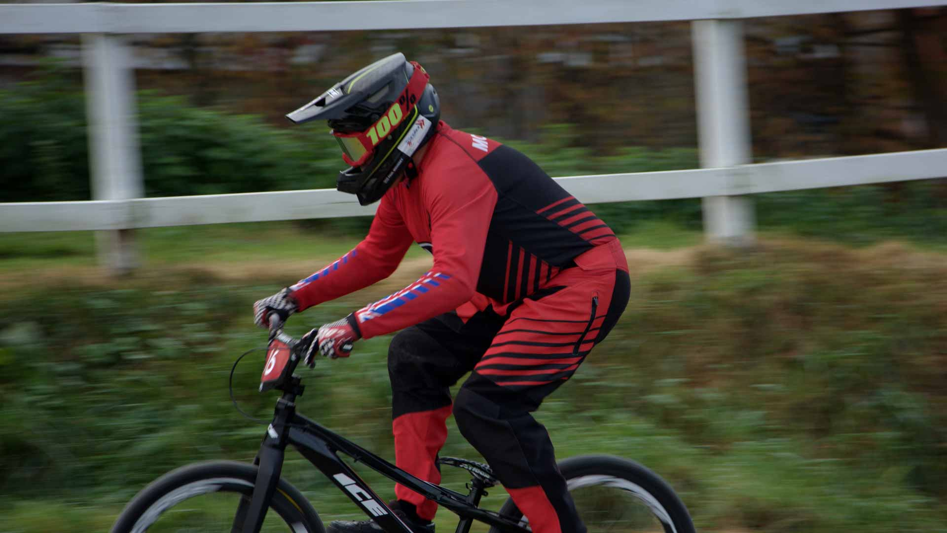 Paul Mounsey riding his BMX round a race track.