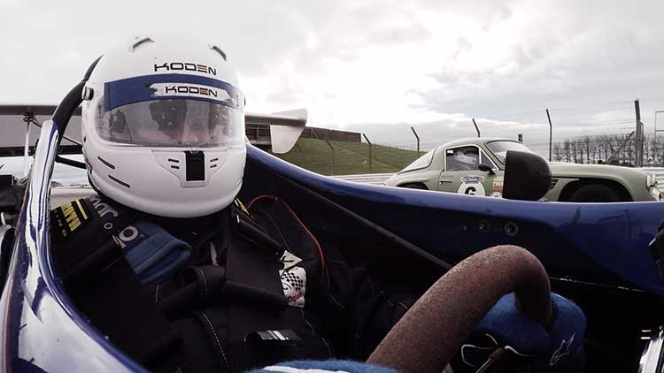 philip in the driving seat of a race car